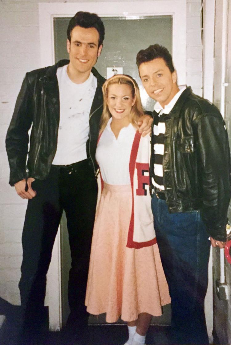 Kenickie (Alex Bourne), Betsy (Lisa Gorgin) and Doody backstage for the opening number